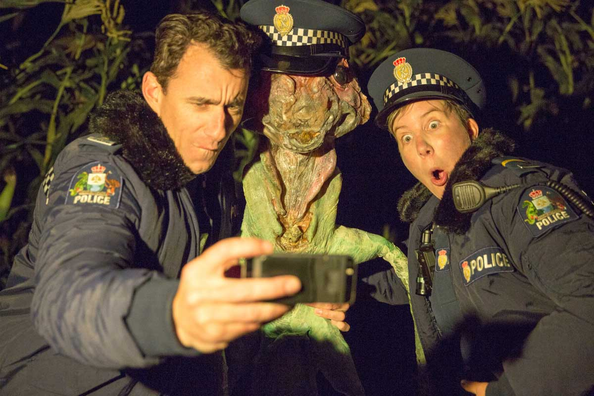 """Mike Minogue as Officer Minoque, Extraterrestrial Flora, Karen O'Leary as Officer O'Leary in """"Wellington Paranormal"""""""