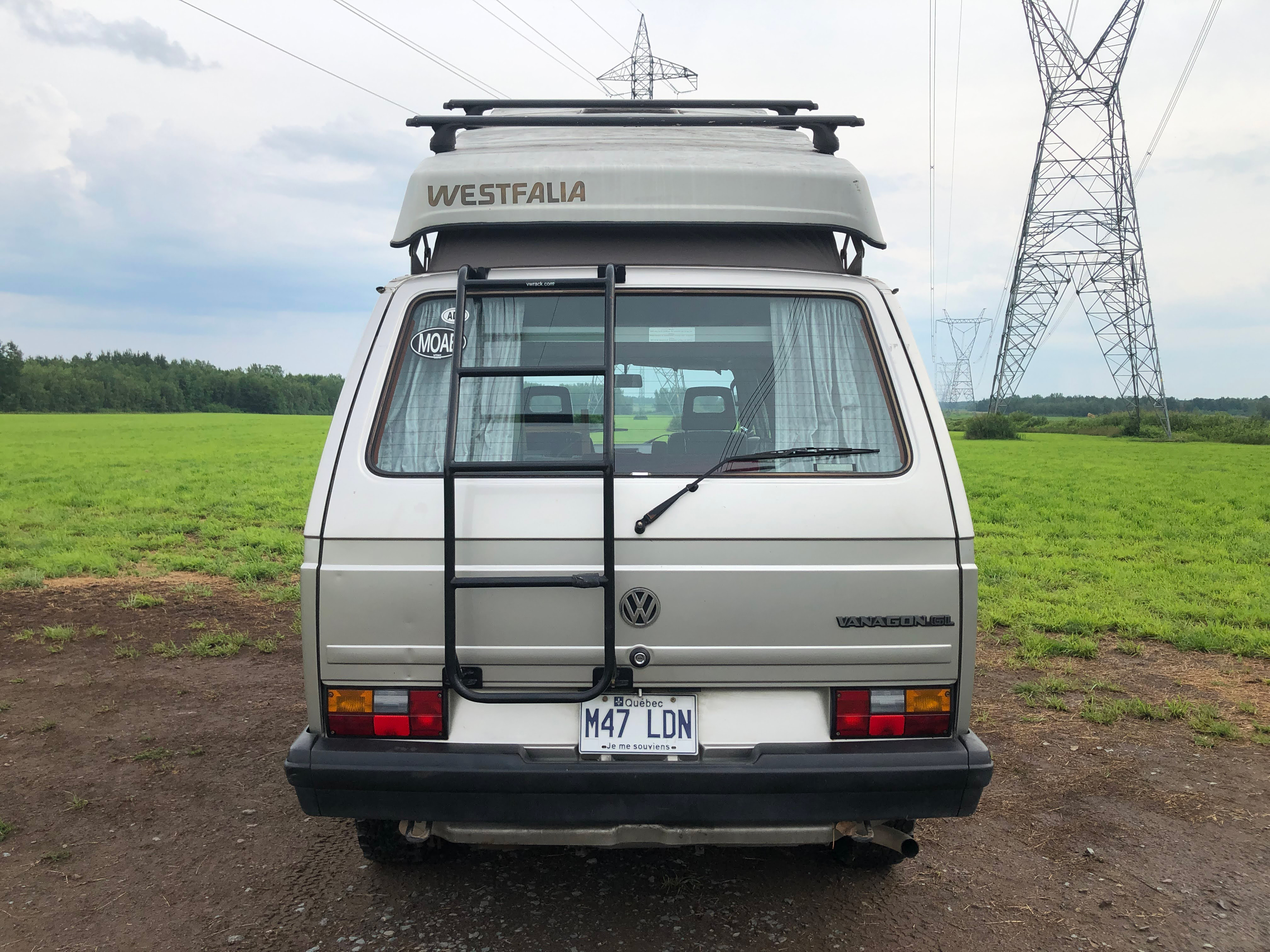 The rear end of a 1990 Volkswagen Vanagon Westfalia. We spoke with someone who owns the camper van to get some insight into buying one.