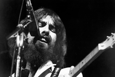George Harrison performs onstage at the Concert for Bangladesh which was held at Madison Square Garden on August 1, 1971 in New York City