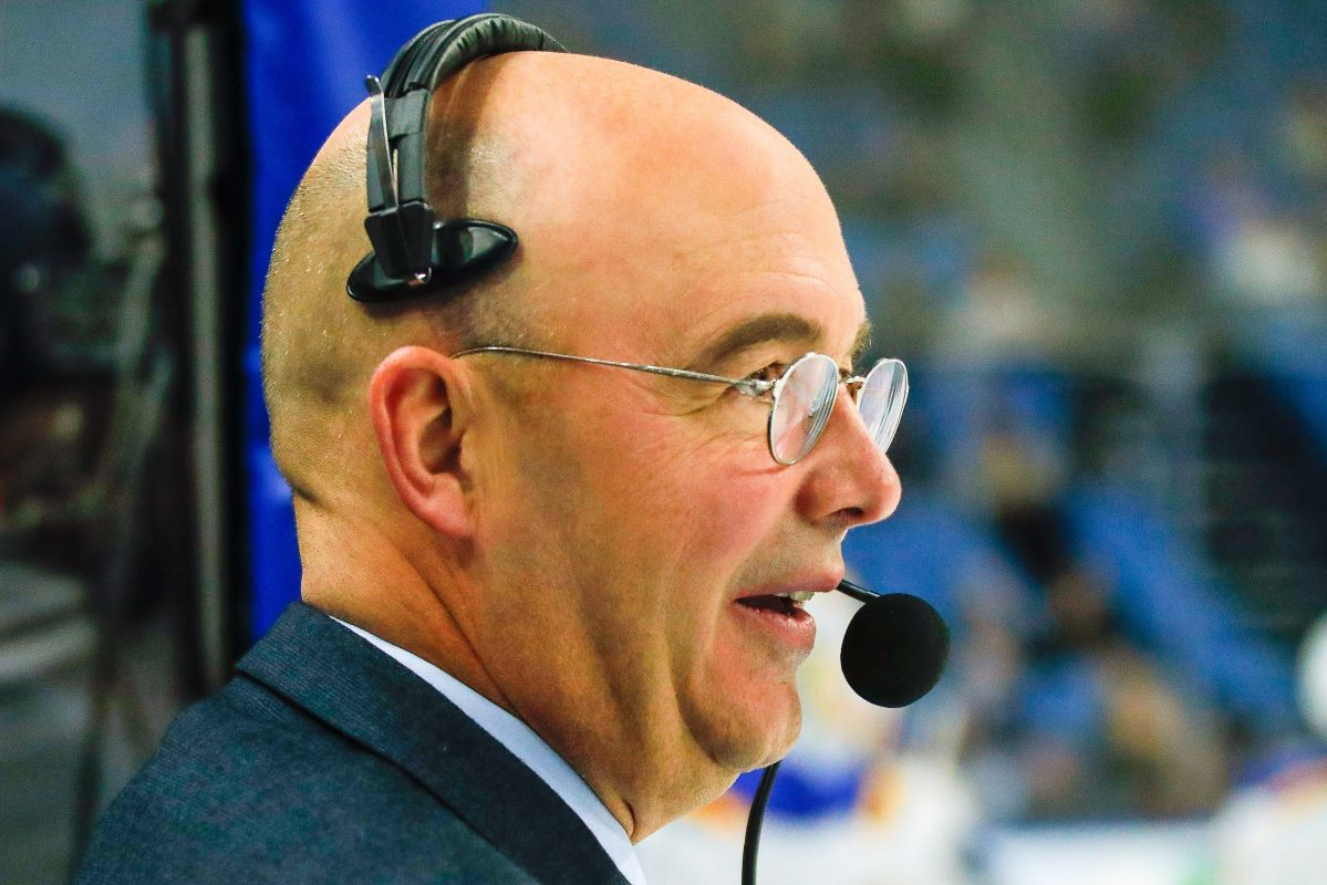 Hockey analyst Pierre McGuire wearing a mic. McGuire was recently appointed VP of player development for the Ottawa Senators.