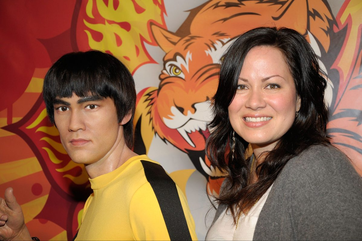 Shannon Lee with a wax statue of her father Bruce Lee at Madame Tussaud's Wax Museum in Hollywood, California