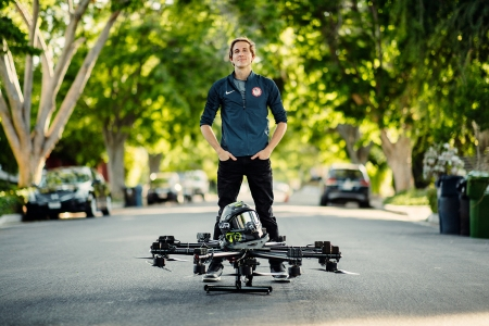 Hunter Kowald standing with hoverboard