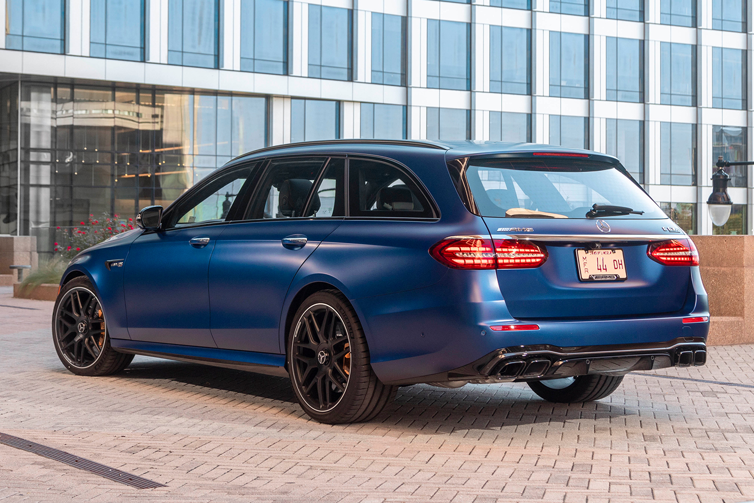 The rear end of a blue 2021 Mercedes-AMG E63 S 4MATIC Wagon. After test driving it for a week, we recommend the super fast station wagon.