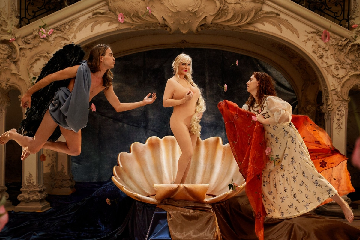 """Pornhub's Classic Nudes initiative is bringing porn to the museum. Photo shows artist and porn legend Cicciolina standing in a clam shell in a parody of """"the Birth of Venus"""""""