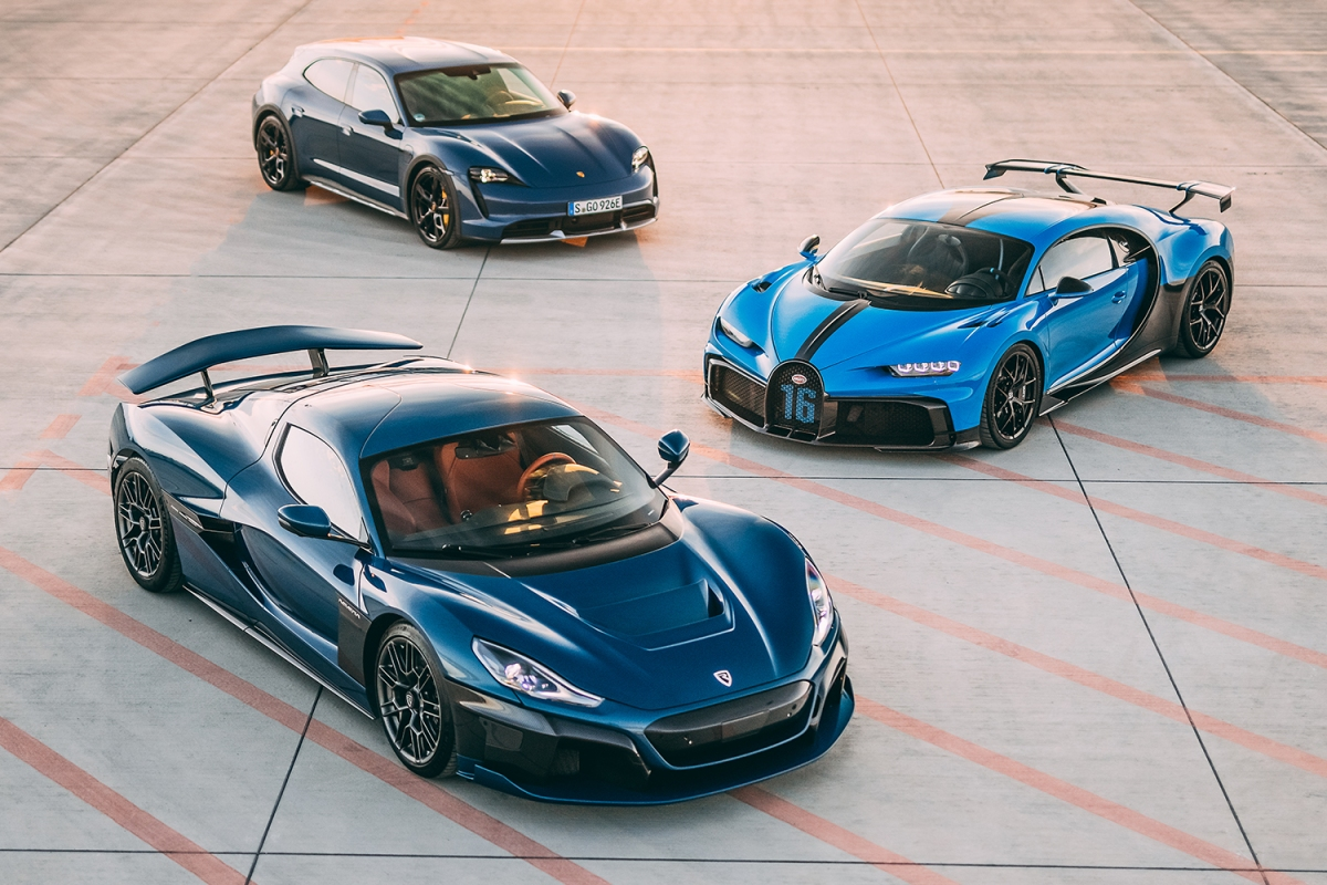 Three cars, one from Porsche, Bugatti and Rimac, all parked next to each other. The three automakers formed a new joint venture, Bugatti Rimac.