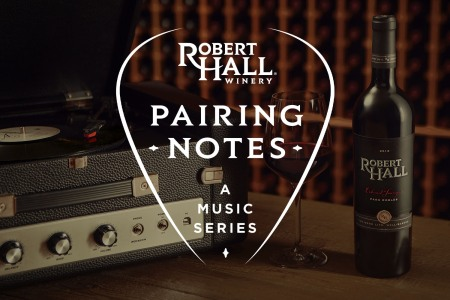 robert hall paring notes logo over a record player and a bottle of wine