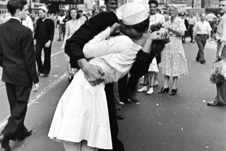 """Alfred Eisenstaedt's iconic """"VJ Day in Times Square"""" shows a WWII soldier kissing a nurse."""