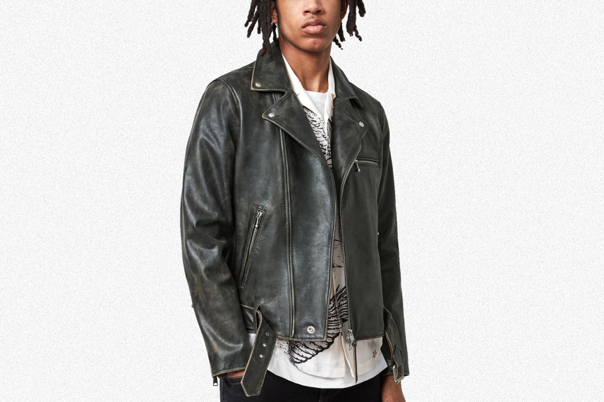The Hank Biker Jacket in black from AllSaints. A model wears the jacket, which is 44% off during a July sale.