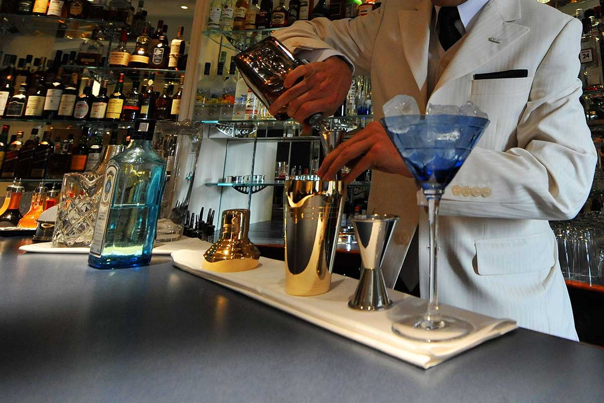 A barman mixes a cocktail in the American Bar in The Savoy Hotel in London, following a 3 year restoration of the hotel. For the first time, an American will run the bar