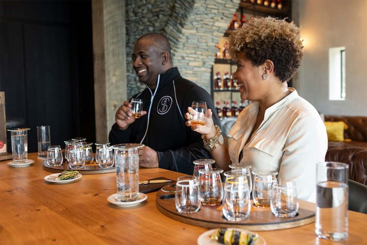 Armond and Samara Davis of the Black Bourbon Society, tasting whiskey. Their collaboration with Maker's Mark is a standout 2021 bourbon.