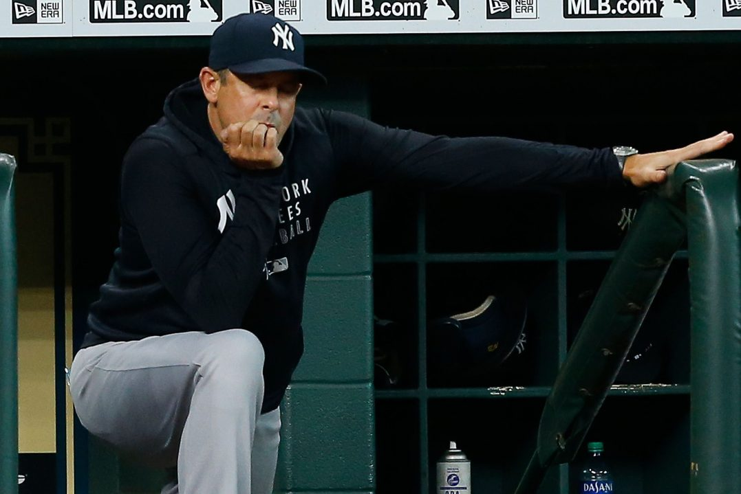 Manager Aaron Boone of the New York Yankees looks on from the dugout.