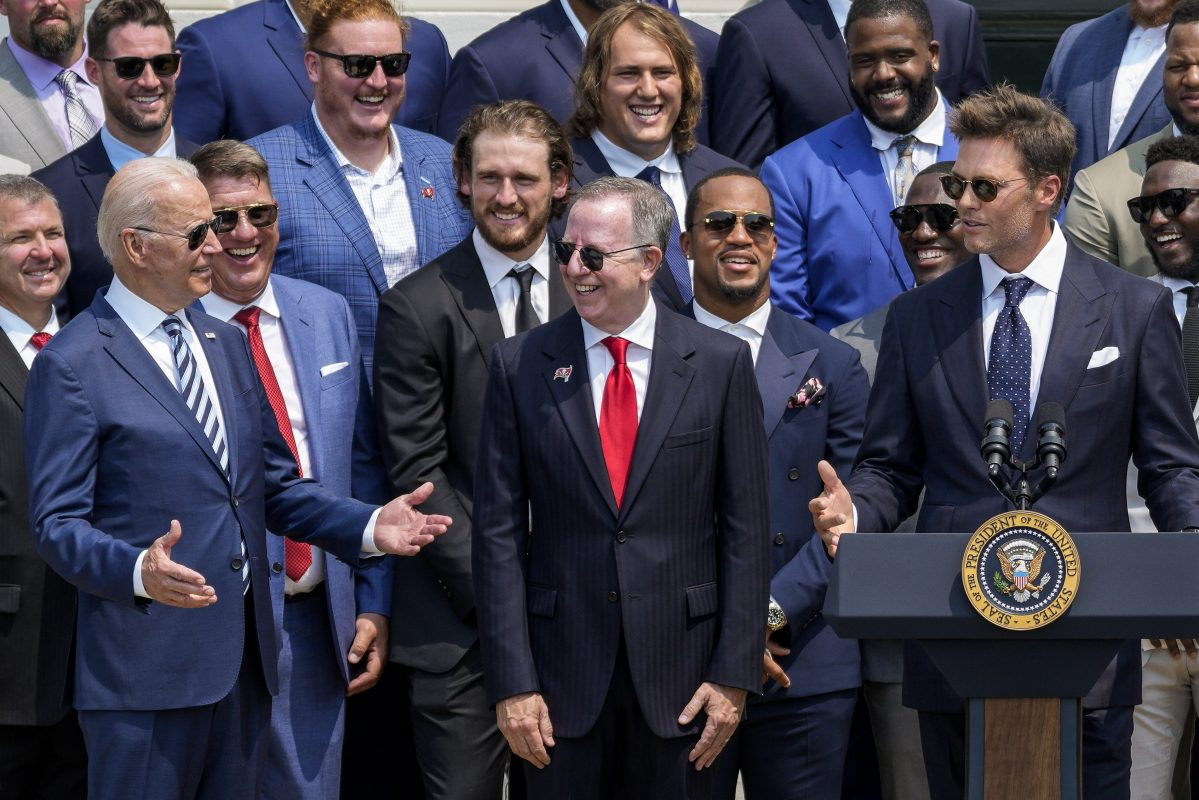 Tom Brady makes jokes with President Joe Biden as the Tampa Bay Buccaneers visit the White House after their Super Bowl win