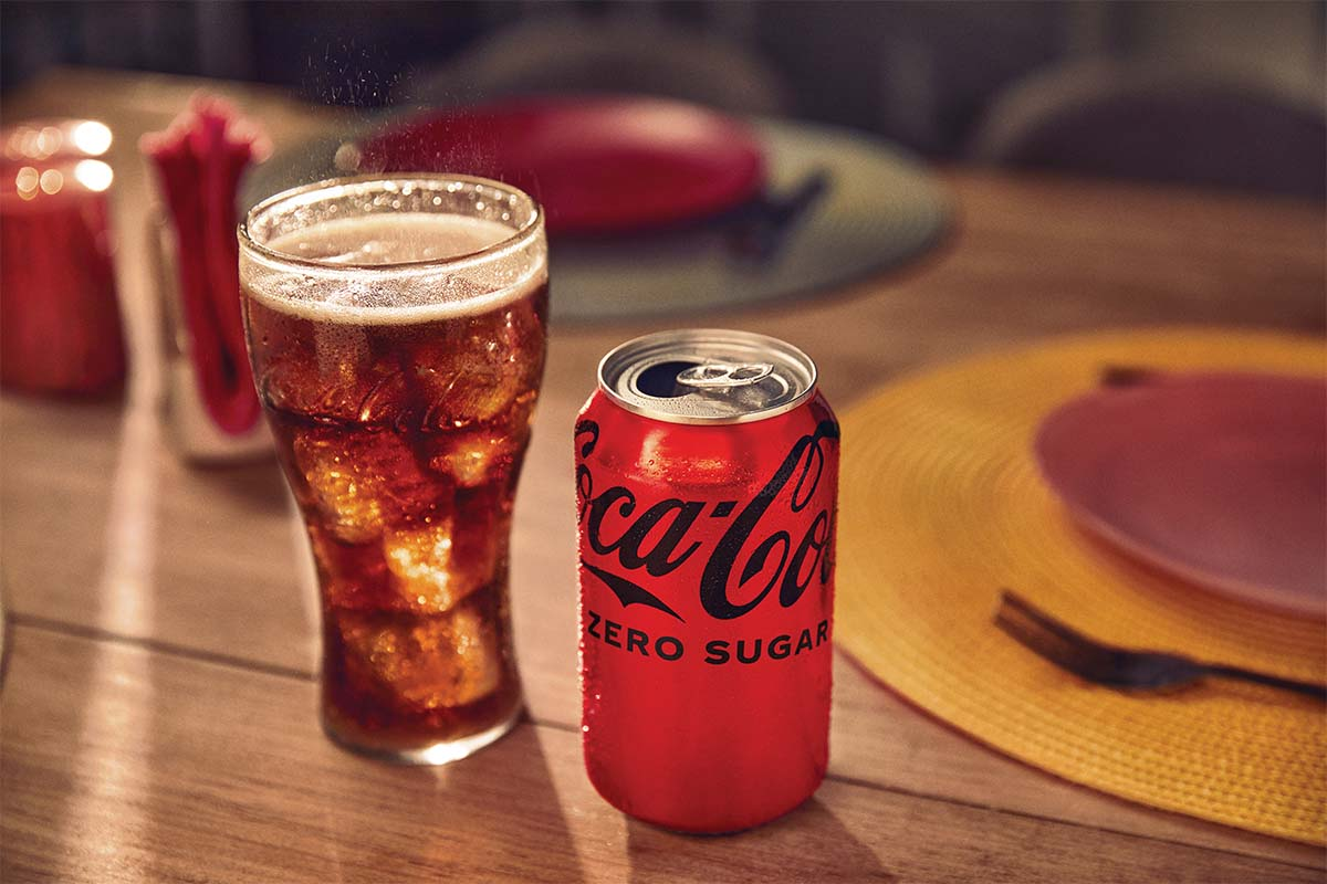 A glass and a can of new Coca-Cola Zero Sugar on a table