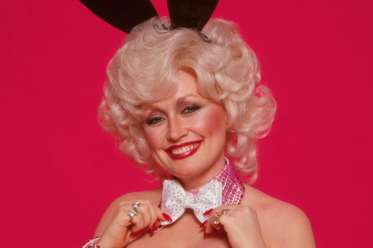 Dolly Parton poses for Playboy in a bunny suit, ears and bow tie