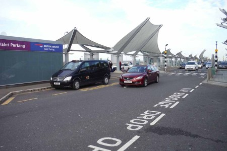 A drop off and a pick up point at Heathrow's Terminal 5. Drop-offs will now cost an extra fee.