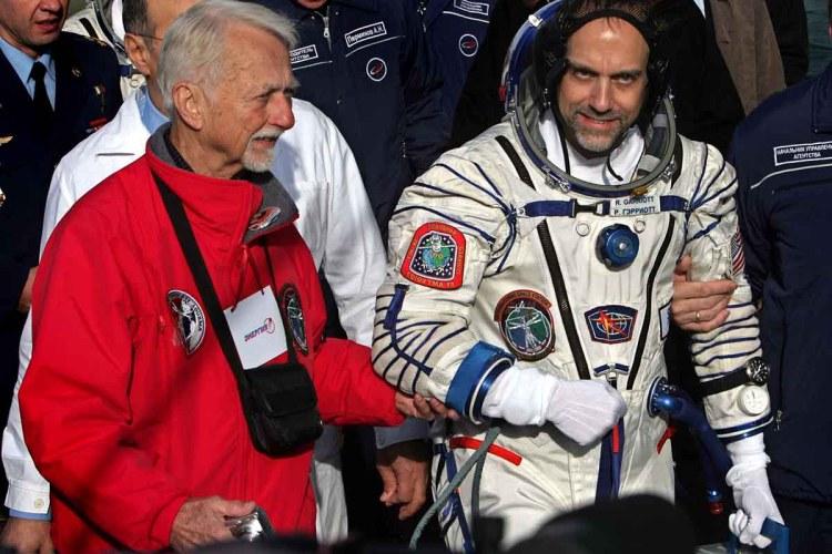 Space tourist Richard Garriott walks with his father US astronaut Owen Garriott before boarding the spacecraft at the Baikonur cosmodrome, in Kazakhstan, on October 12, 2008.