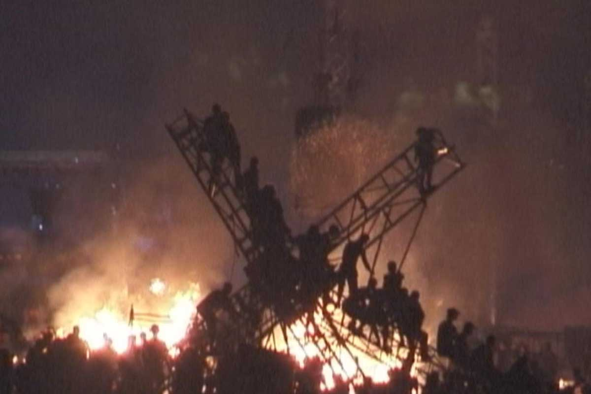An image of burning stage or lighting rig from Woodstock 99, as shown on a new HBO documentary