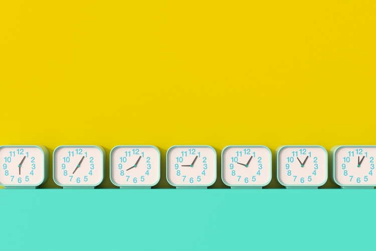 A series of seven clocks with different times lined up against a yellow and teal background