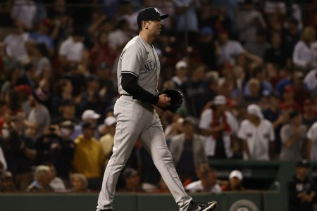 Brooks Kriske walks back to the mound after throwing a wild pitch. His performance led the New York Yankees to a loss against the Boston Red Sox.