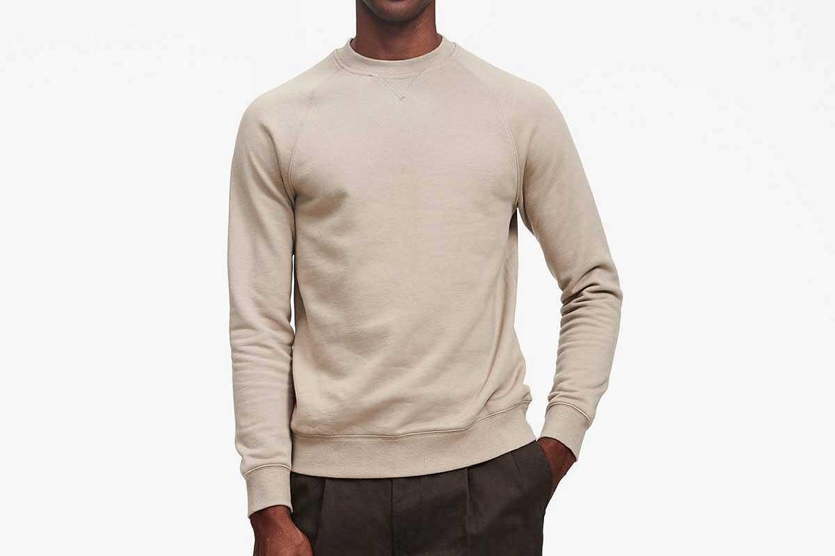 Sage green fleece sweatshirt on a man, via Naadam (now on sale)