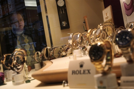Why buy a Rolex full-price when you can bid on a used criminal's?