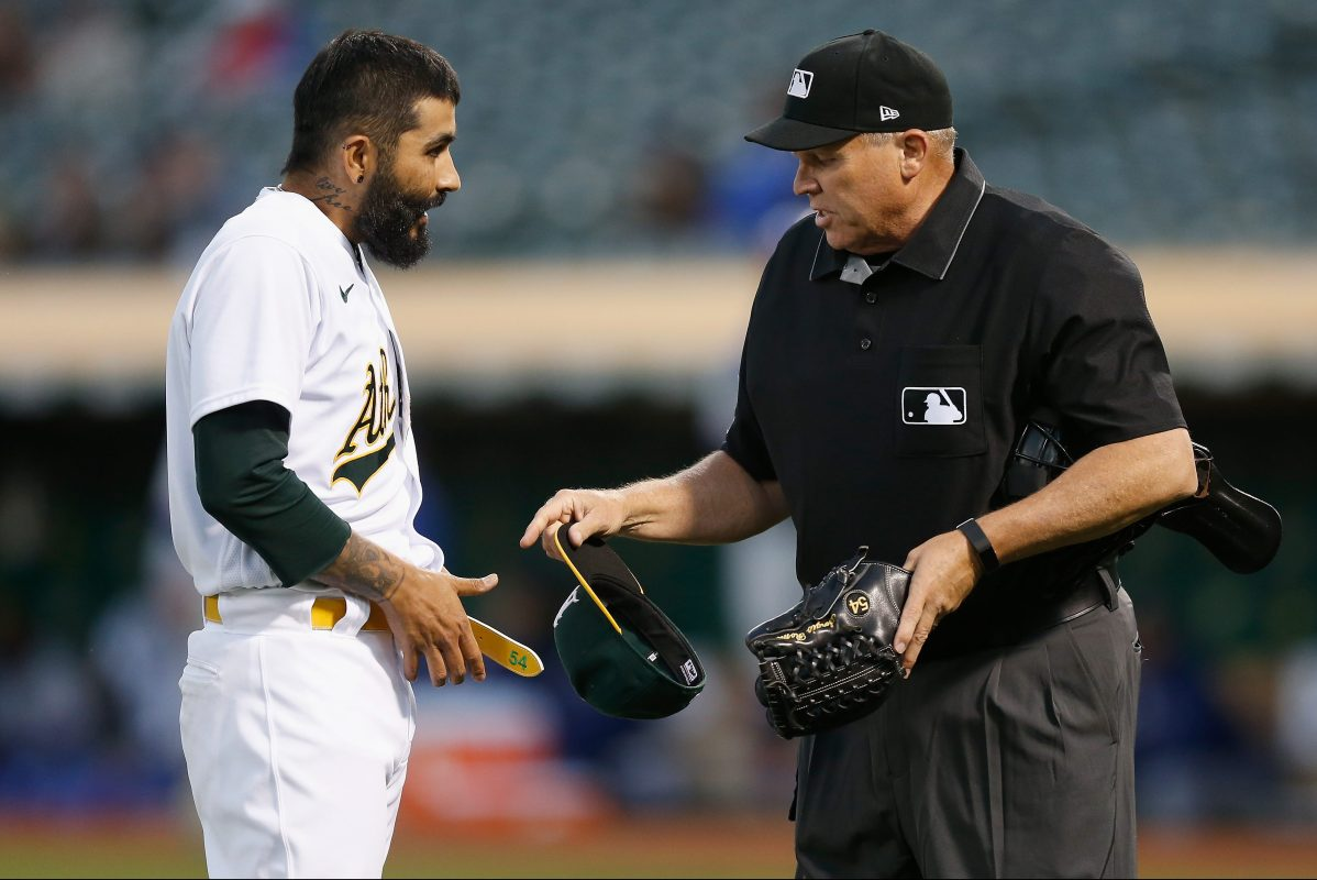 Sergio Romo is inspected for foreign substances