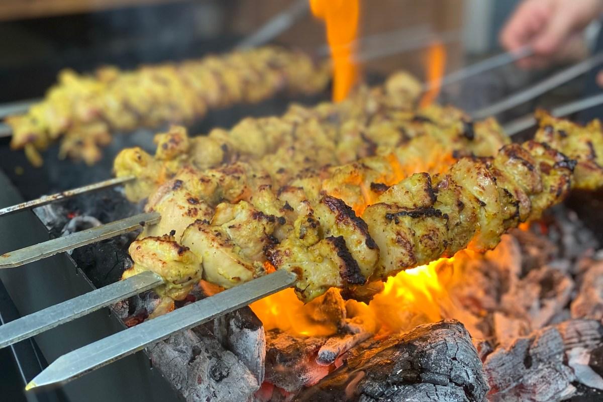 Roya's Persian chicken kabobs over an open flame