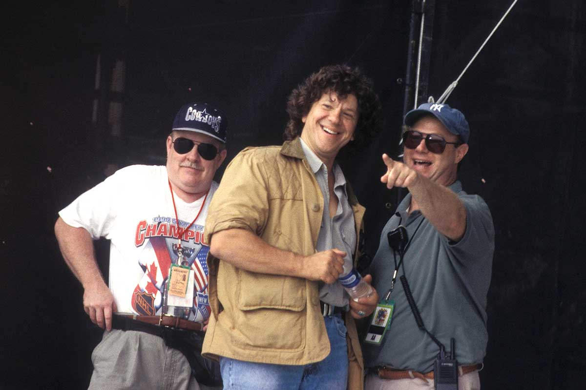 Woodstock creator and promoter Michael Lang and John Scher are shown on stage at Woodstock 99 in Rome, New York on July 24, 1999.