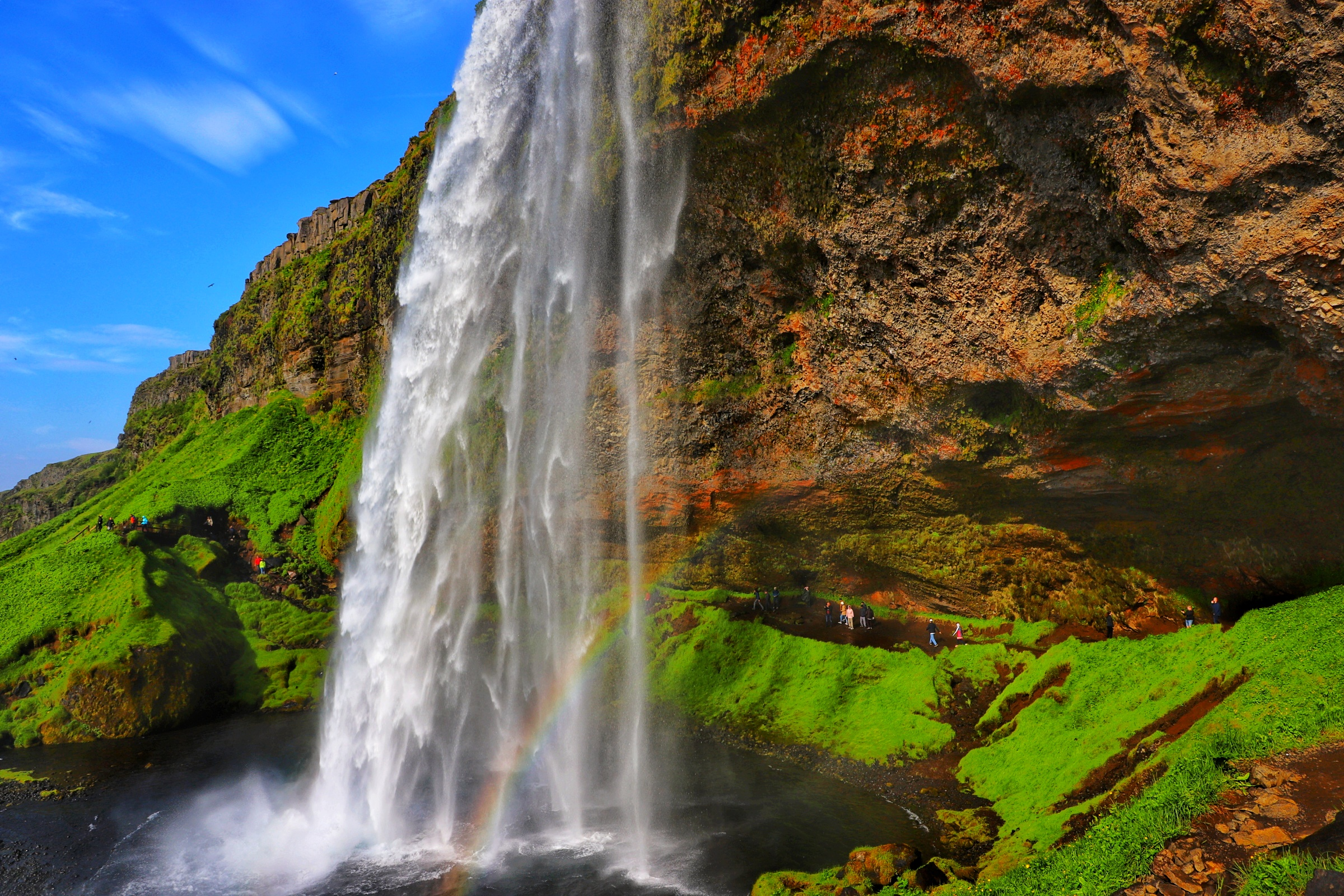 Visitors to Iceland's Seljalandsfoss waterfall are able to enjoy a view looking out from beyond the falls