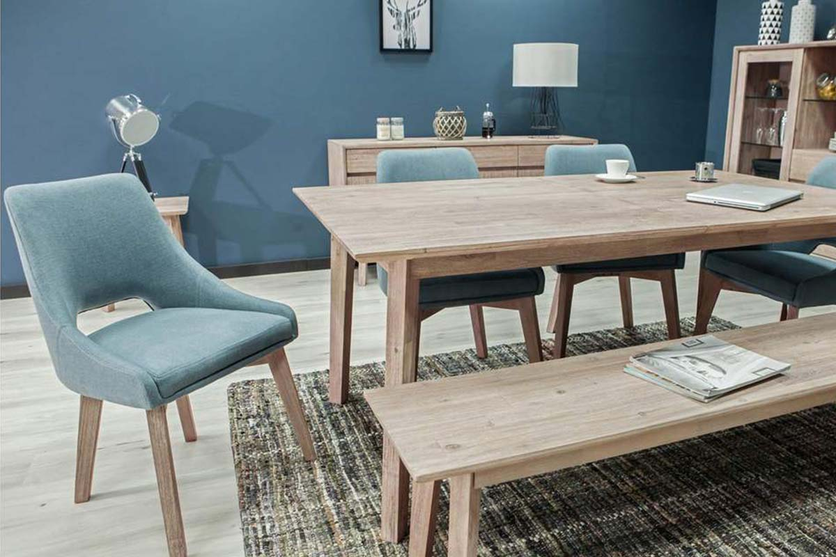 A room featuring the Clara Extendable Dining Table and other Apt2B furniture, now on sale