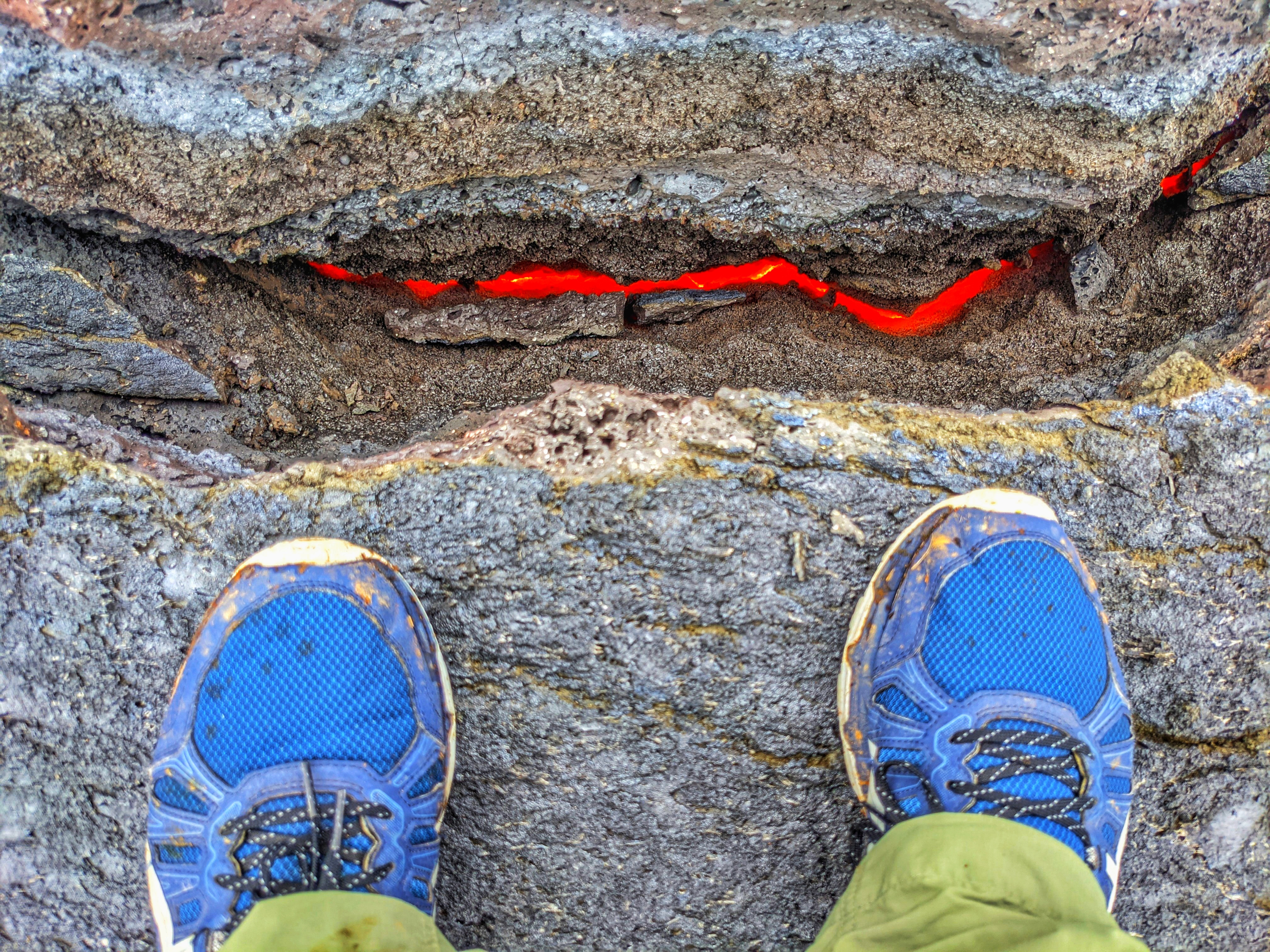Watching the lava flow underneath my feet at the Fagradalsfjall volcano in Iceland