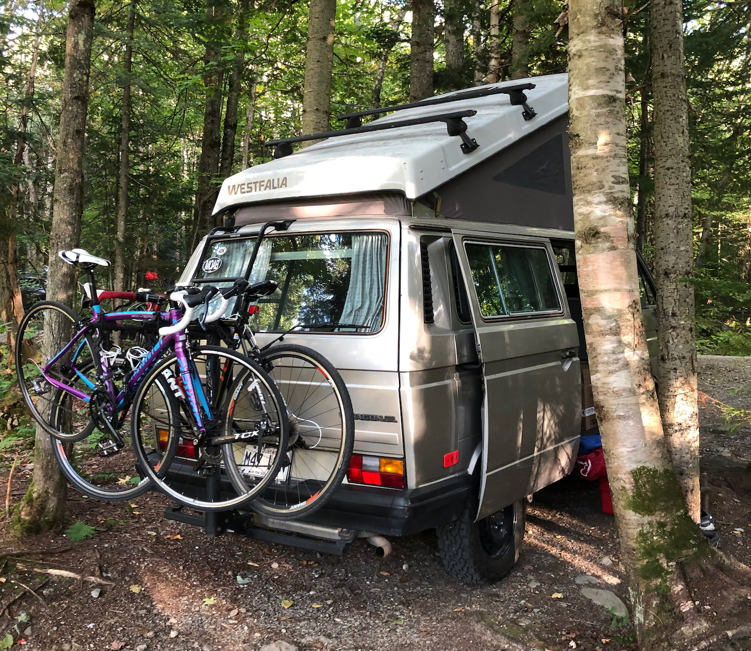 A bike rack on the back of a 1990 Volkswagen Vanagon Westfalia. That's just one of the tips we got from someone who owns the camper van.