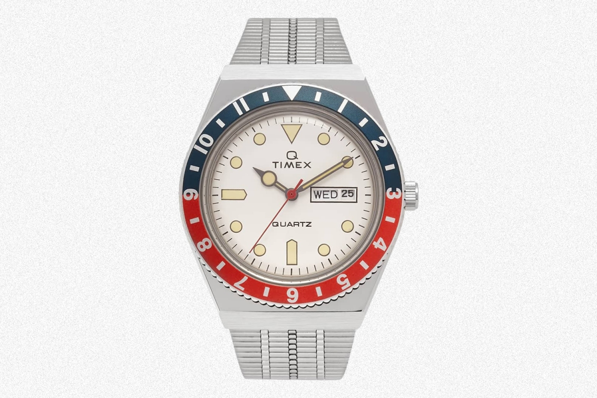 A white-dial Q Timex with a red and blue bezel. The quartz watch is on sale at End Clothing for 50% off.
