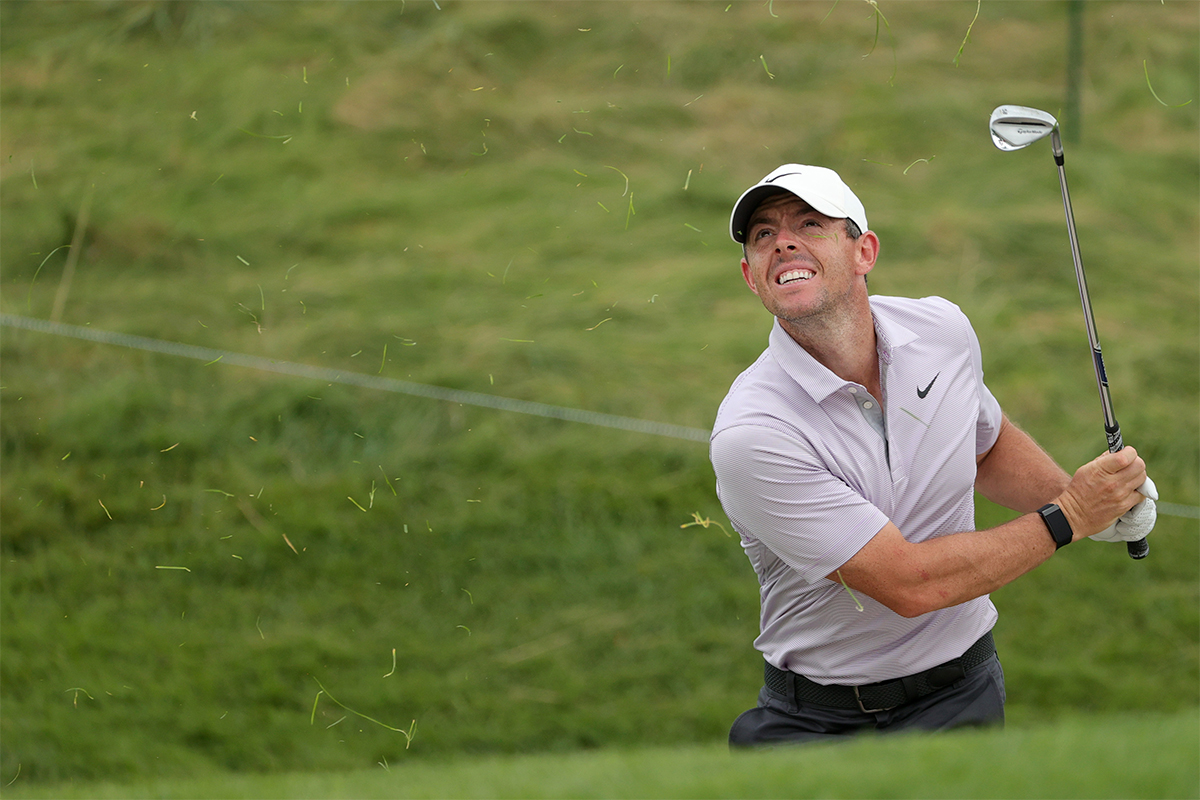 Rory McIlroy hitting a shot in a tournament. The pro golfer will soon have played 34 events in just 15 months, as of September 2021, and thus deserves much more than two weeks off from the game.