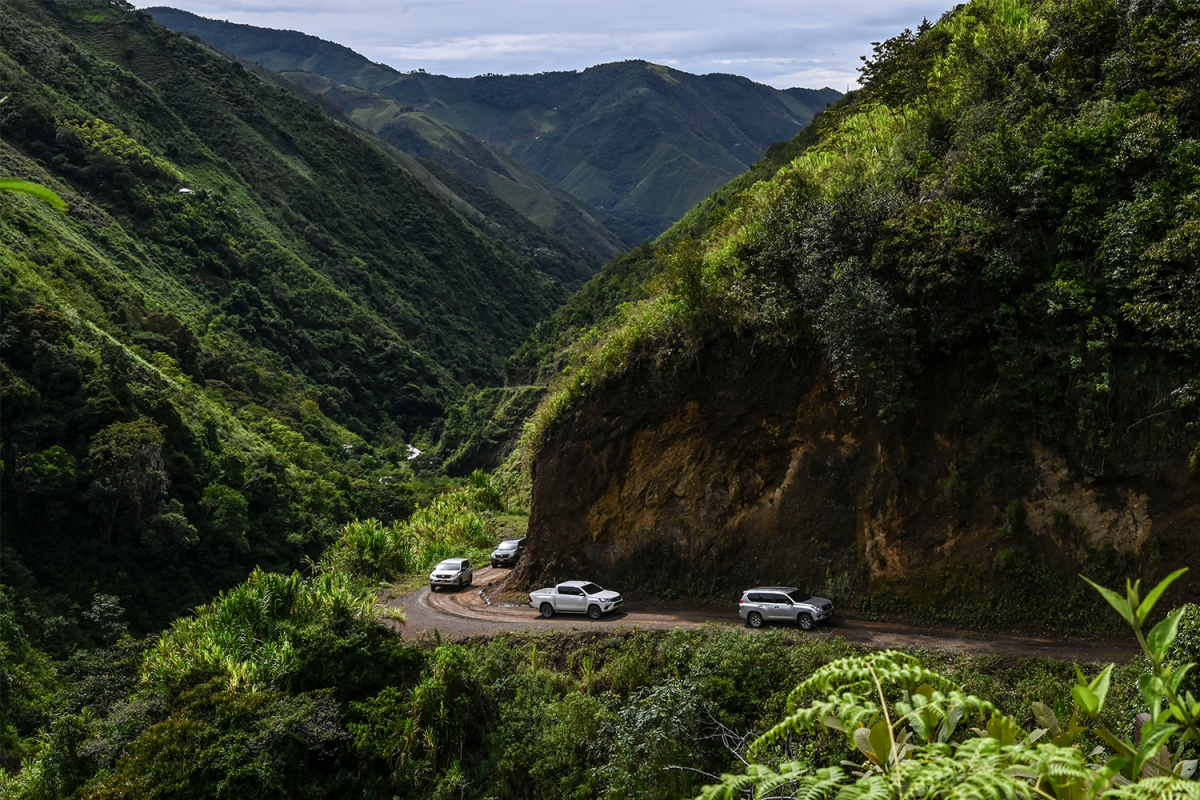 A security caravan transporting a former FARC guerrilla commander drives through the jungle near Ituango in Colombia
