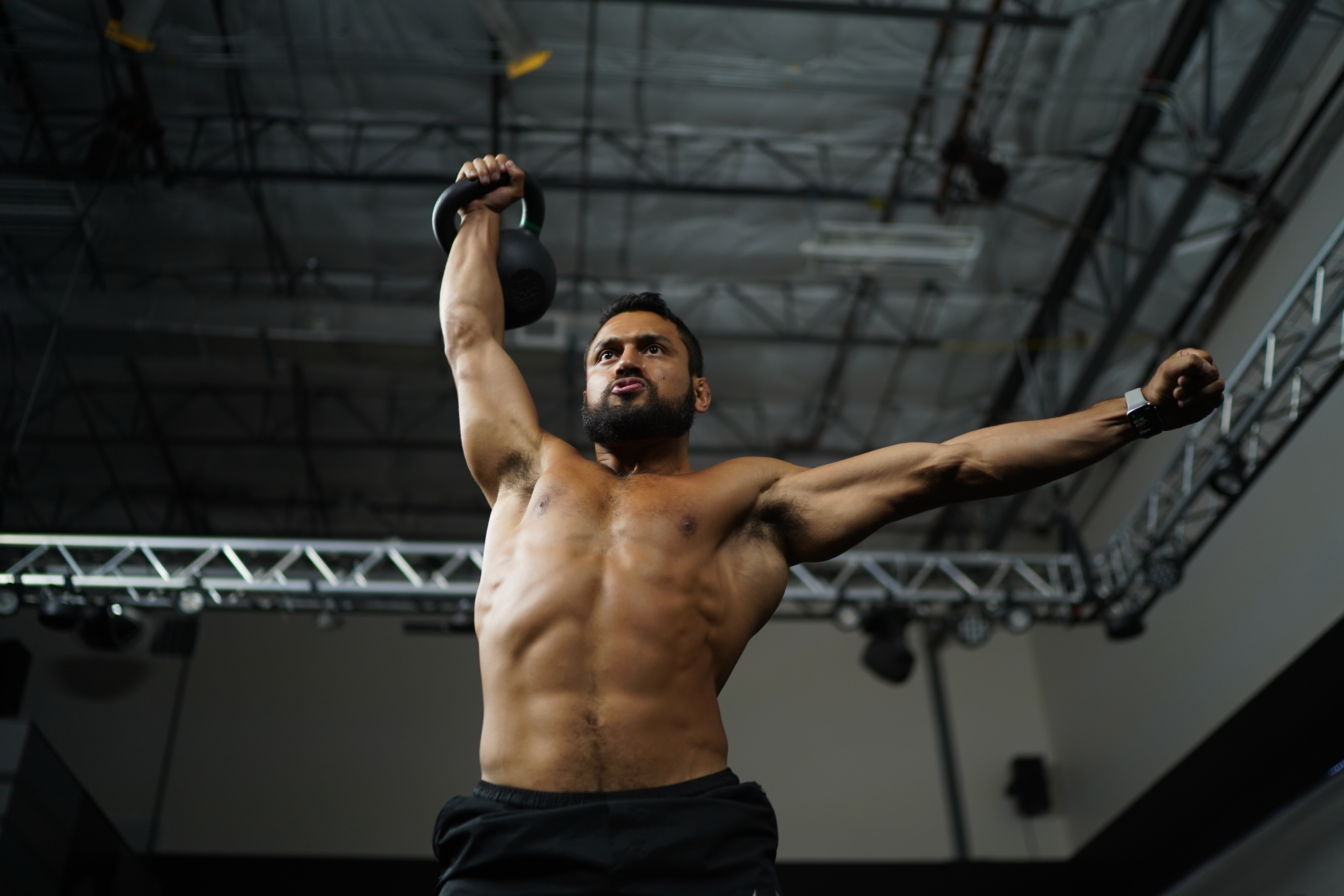 Eric Leija performing a snatch, a classic kettlebell exercise