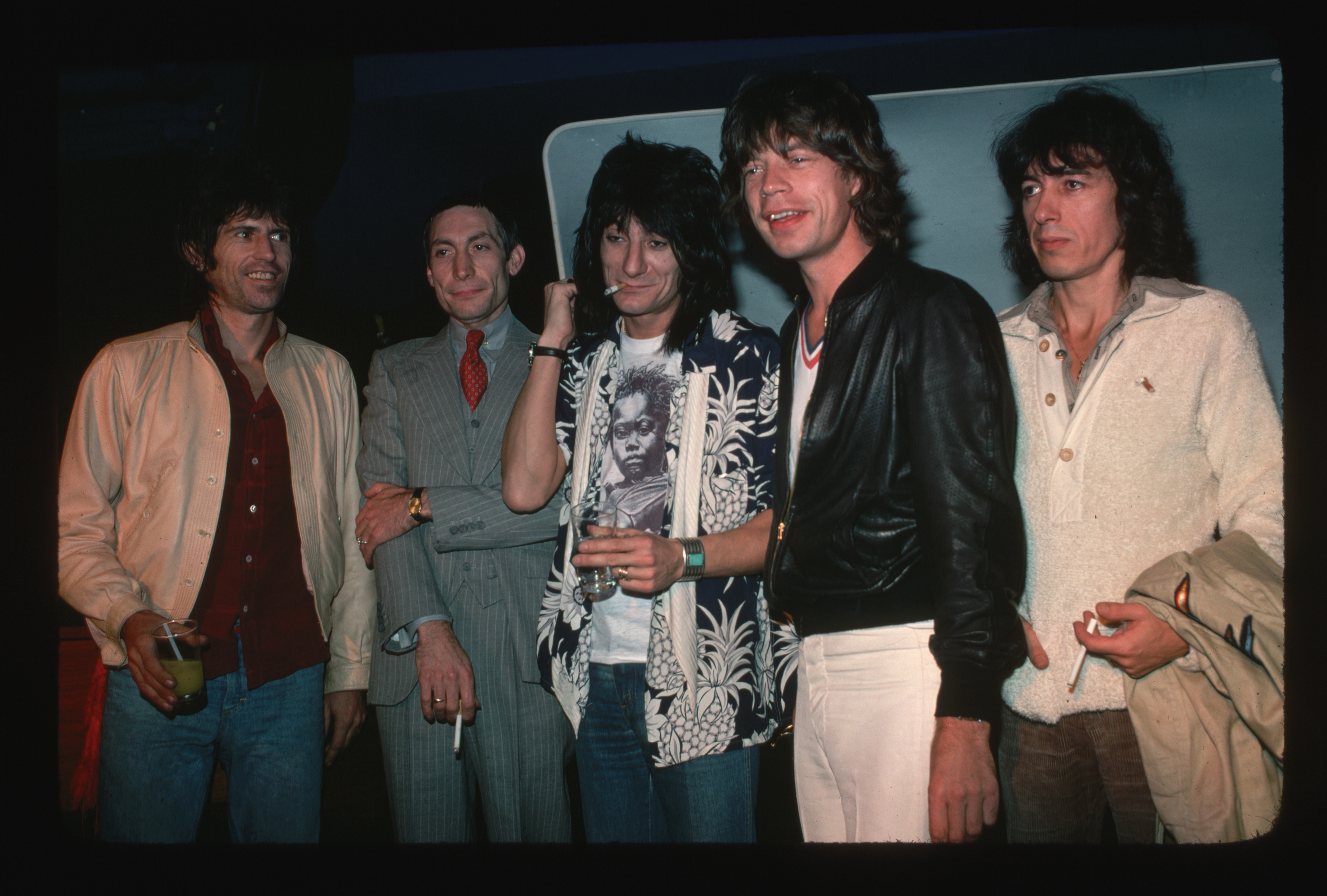 rolling stones, with charlie watts in a double breasted suit