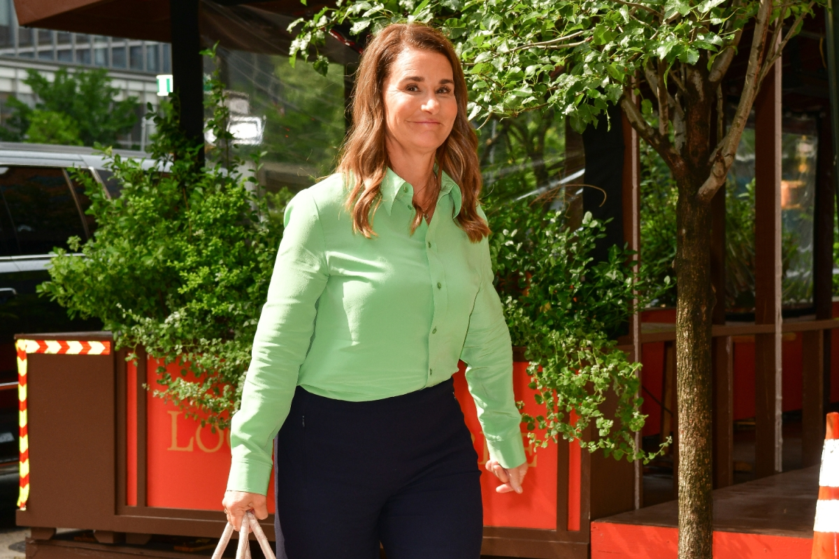 Melinda French Gates seen on the streets of Manhattan wearing a green shirt, black pants and carrying a hand bag.