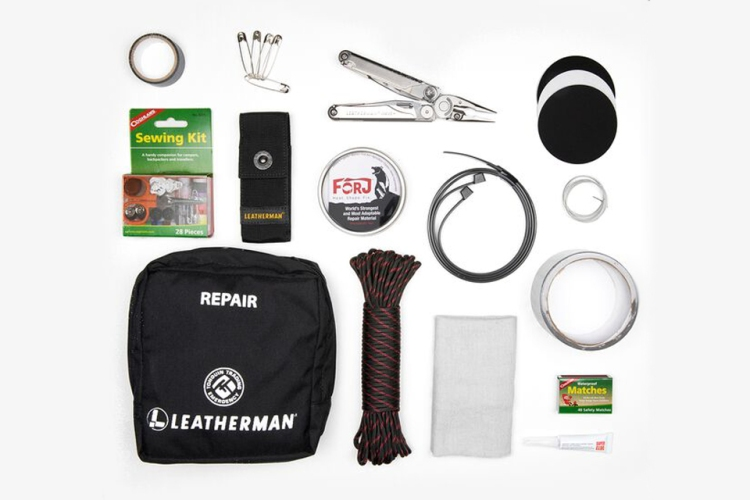 All the tools and gear in the Leatherman Wave+ Repair Kit, including the multitool as well as paracord, matches, a sewing kit and more.