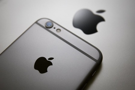 Back of a grey/silver iPhone with the Apple logo on and above it. Apple just released an important security fix.