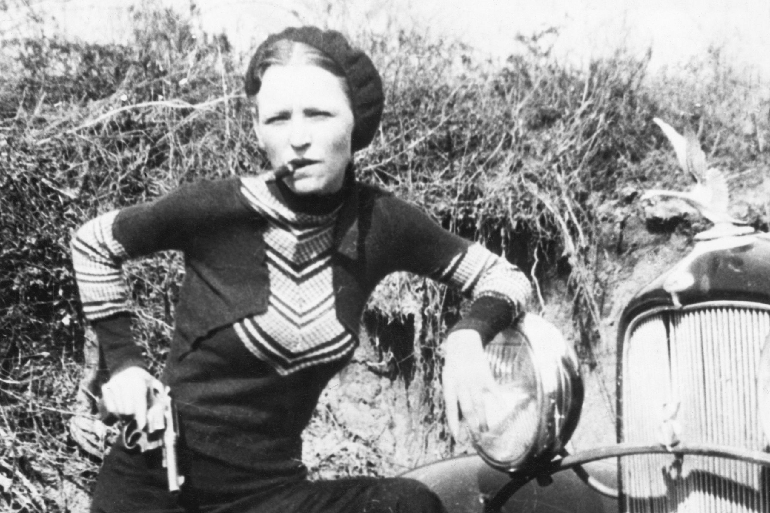 Bonnie Parker, partner of Clyde Barrow, smoking a cigar
