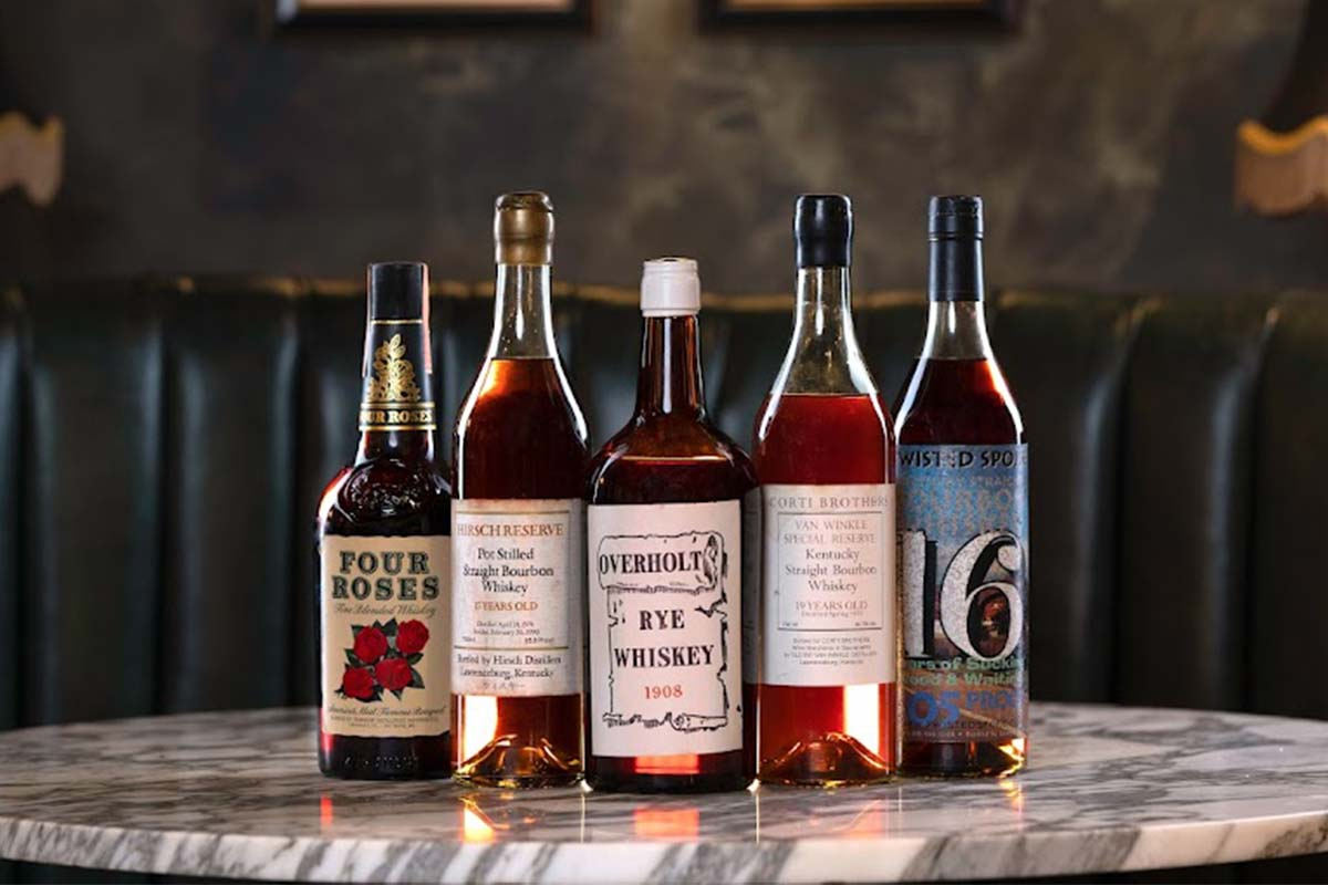 """Highlights from the """"A Century of American Whiskey"""" auction ft. 1948 Four Roses, the first legendary A.H. Hirsch 1974 Reserve, Pre-Prohibition Old Overholt, 1975 Van Winkle for Corti Brothers and the very rare Van Winkle Twisted Spoke bottling. All the bottles are part of the"""