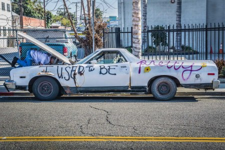 """A used car with spray paint on it that reads """"I used to be pretty"""""""