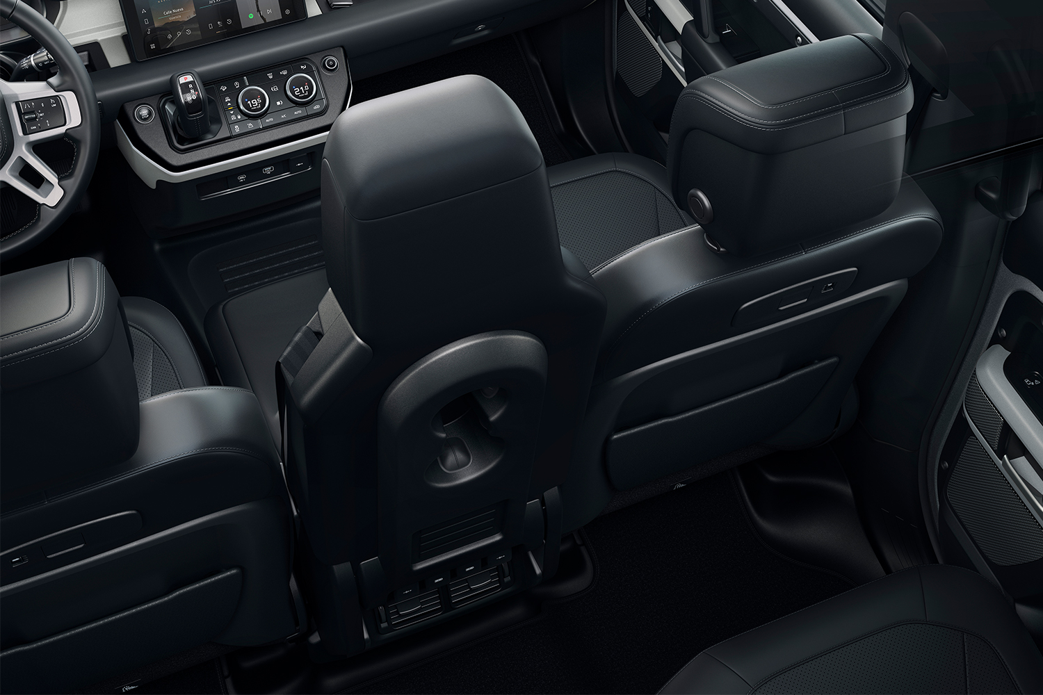 The available folding front jump seat in the 2021 Land Rover Defender 90 luxury SUV. After reviewing the vehicle, we think it would be a little too tight with the option.
