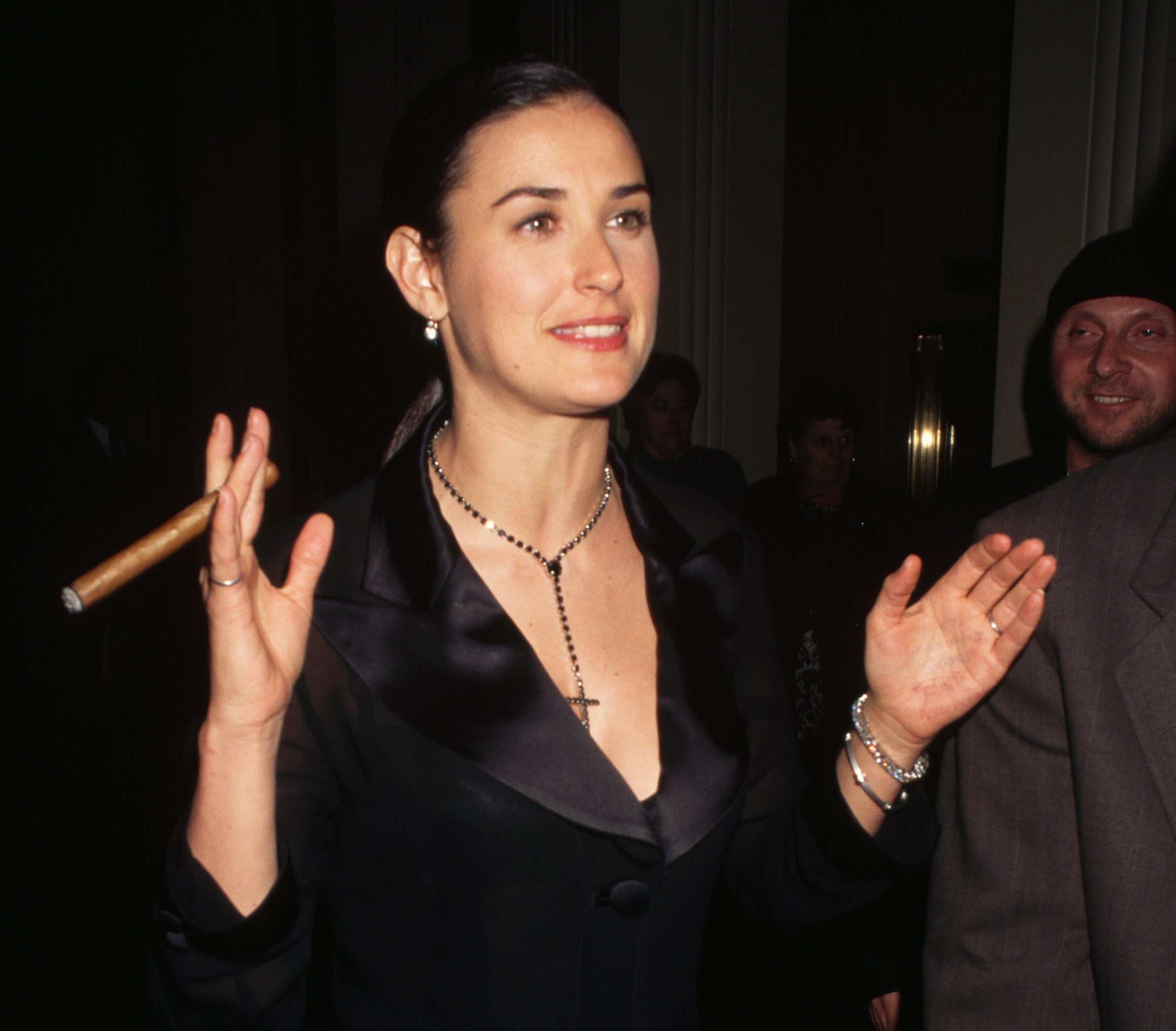 Demi Moore enjoys a cigar outside of Carnegie Hall in 1995