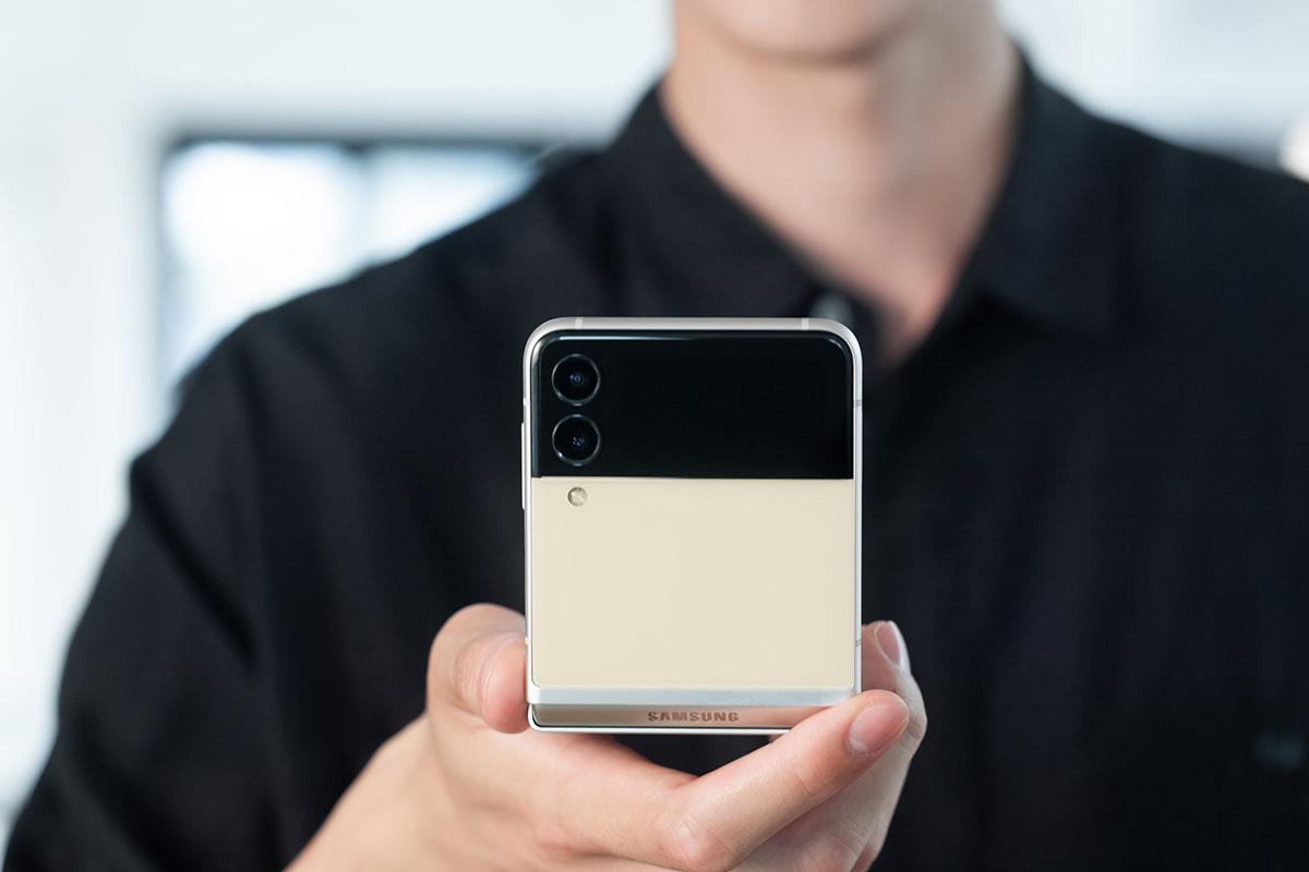 man holding a folded Samsung Z Flip3