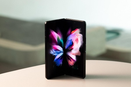 Samsung Z Fold3 sitting on a table, unfolded