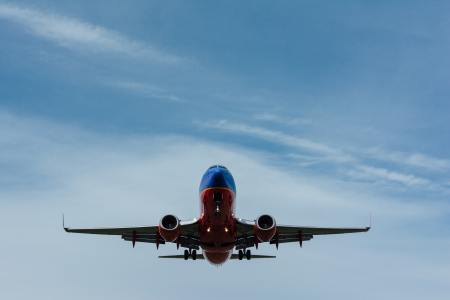a commercial airplane in flight in the sky