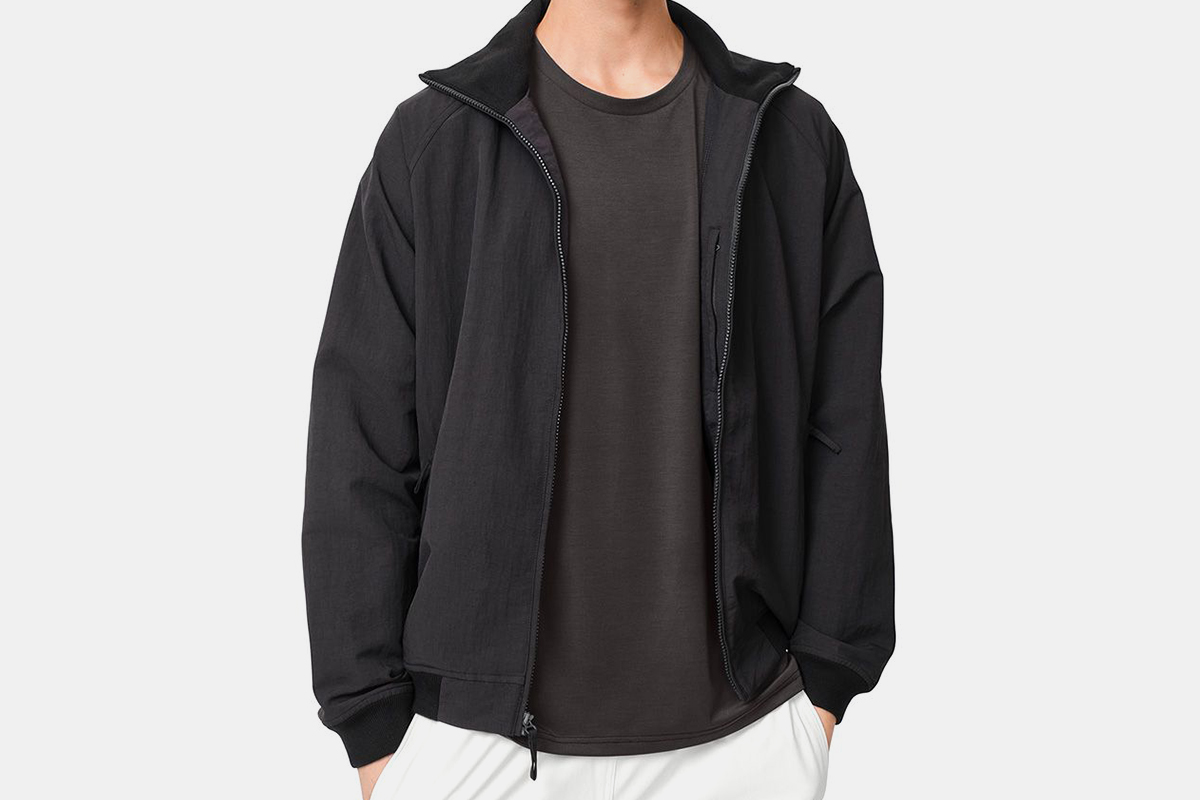 The Outdoor Voices Interstate Jacket in black. Get the men's nylon activewear layer on sale for 65% off.