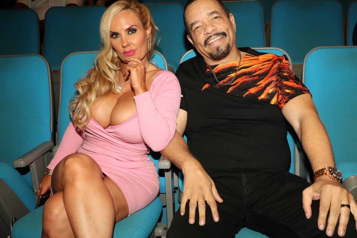 Ice-T and Coco Austin sit together in movie theater seats. The rapper recently courted controversy when he said he likes to suck his wife's breasts, just like their child.